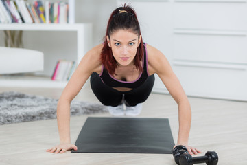 Woman in plank exercise position
