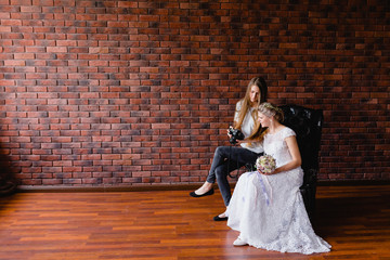 Photographer shows the bride had just taken photos on a large leather armchair