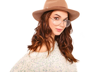 Portrait of young stylish girl model in casual summer clothes in brown hat with natural makeup in glasses isolated on white background. Looking at camera
