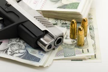 gun and czech banknotes, crime concept