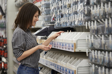 woman working at hardware store