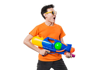 Young man holding water gun on white background.