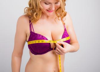 Woman measuring her bra size