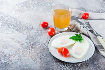 Two fried eggs for breakfast .