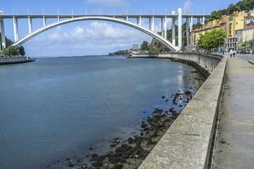 Street view, brirge and Douro river, Porto, Portugal.