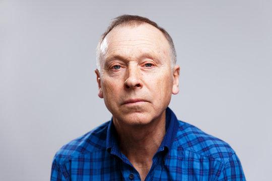 Portrait of a tired elderly man
