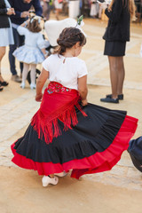 Rear view child dancing wearing typical spanish regional costume. Flamenco. Andalucia. Spain