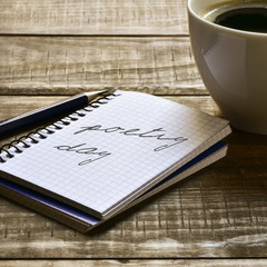 text poetry day in a notebook and a cup of coffee
