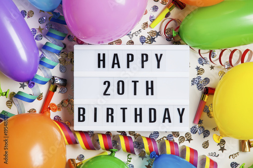 Happy 20th Birthday Celebration Message On A Lightbox With Balloons And Confetti