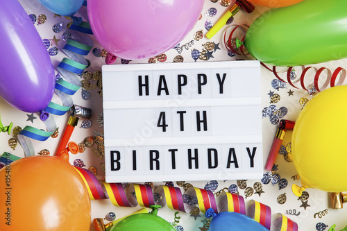 Happy 4th Birthday Celebration Message On A Lightbox With Balloons And Confetti