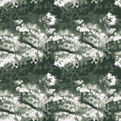 Seamless green and white fashion vector pattern with imitation of texture of unusual urban camouflage. Can be used as camo print for clothes or wrapping paper or as backdrop and wallpaper