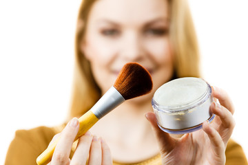 Smiling woman holding make up brush