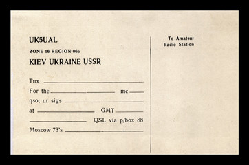 vintage empty QSL radio card, kiev, ukraine, ussr, circa 1980s. paper document isolated on black background