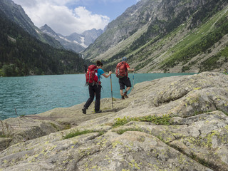 Man and woman hiking in the High Pyrenees near Gaube Lake, Cauterets, France