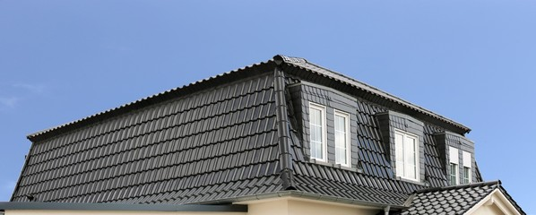 Panoramic picture of a new roof on a residential building