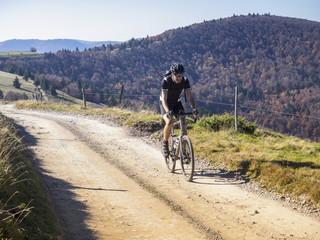 Cyclocross rider on cycling tour near Grand Ballon, Vosges, France