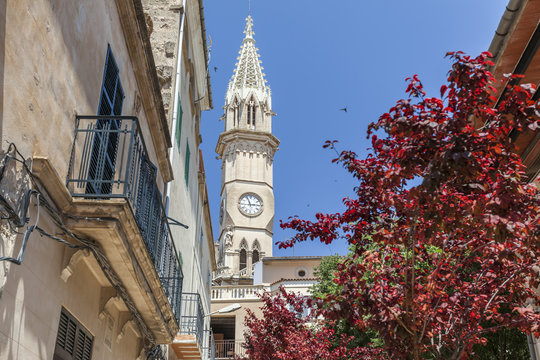 Village view, facade building, flowers and tower church, historic center of Manacor, Mallorca Island, Balearic Islands.Spain.