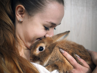 A cute girl with a rabbit. Portrait