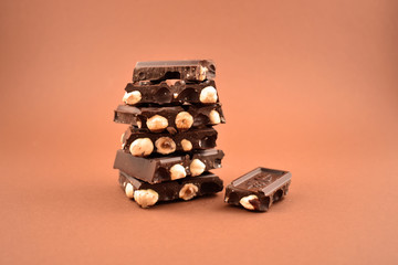 Pile of Chocolate stock images. Nut chocolate on a brown background