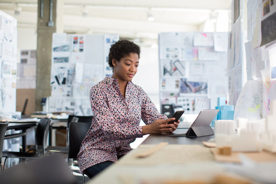 African american female working in creative office