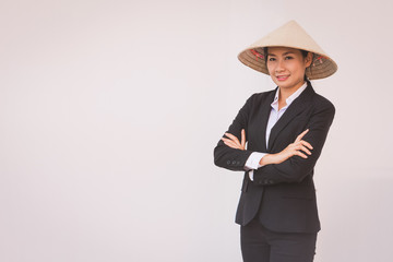 businesswoman wearing Vietnamese hat