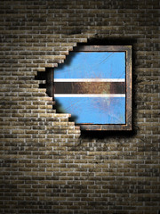Old Botswana flag in brick wall