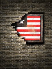 Old Liberia flag in brick wall