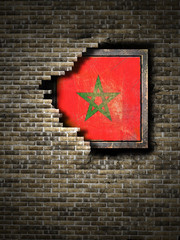 Old Morocco flag in brick wall