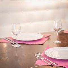 Served dinner table in a restaurant. Restaurant interior. Cozy restaurant table setting