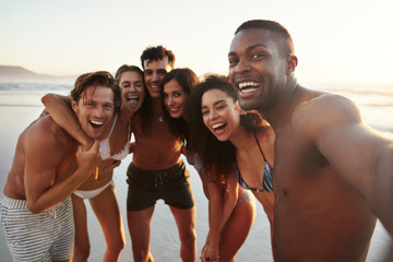 Group Of Friends Posing For Selfie Together On Beach Vacation