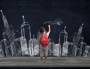 asian boy and backpack drawing city on chalkboard background and and imagination dream flying airplane.Kid Creativity Education Concept