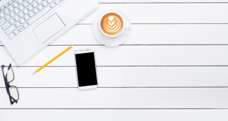 phone coffee laptop view from above wooden white background