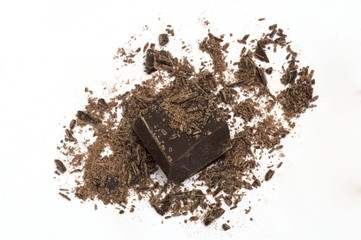 piece of dark chocolate on white background