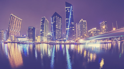 Fisheye lens picture of Dubai Marina at night, color toned picture, United Arab Emirates.