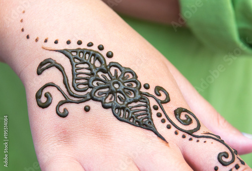 Henna Tattoo On A Hand Floral Motif Drawing Henna Being Applied To