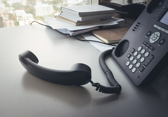 Telephone on desk in office.