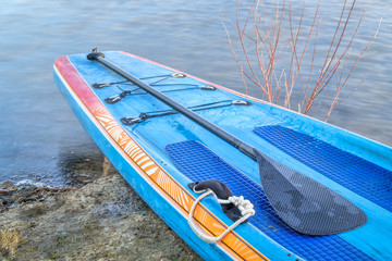 stand up paddleboard with a paddle