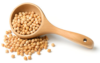 dried raw chickpeas in the wooden spoon, isolated on white