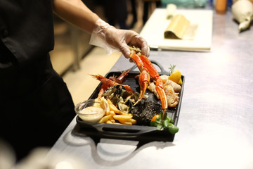 Chef preparing seafood platter for serving in restaurant