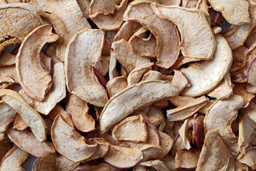 Background of sliced dried apples. Dried fruits.