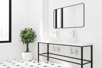 White tiled bathroom double sink side view