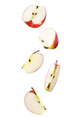 Falling sliced apple isolated on white background