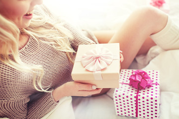 Fototapete - close up of woman with birthday gifts in bed