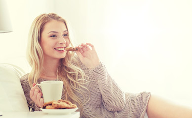 Fototapete - happy woman with coffee and cookies in bed at home