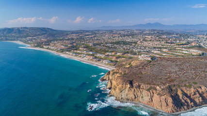 Aerial view of the California coastline in Orange County on a sunny day.