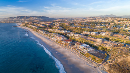 Aerial view of Southern California beach in Dana Point, Orange County on a sunny afternoon.
