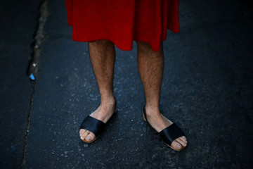 A man wears a dress as he attends a march to mark International Women's Day in Santiago