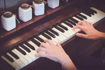 Hand play old piano with vintage tone
