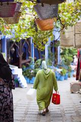 Woman walking, in Chefchaouen