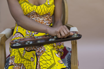 Woman playing Awale game